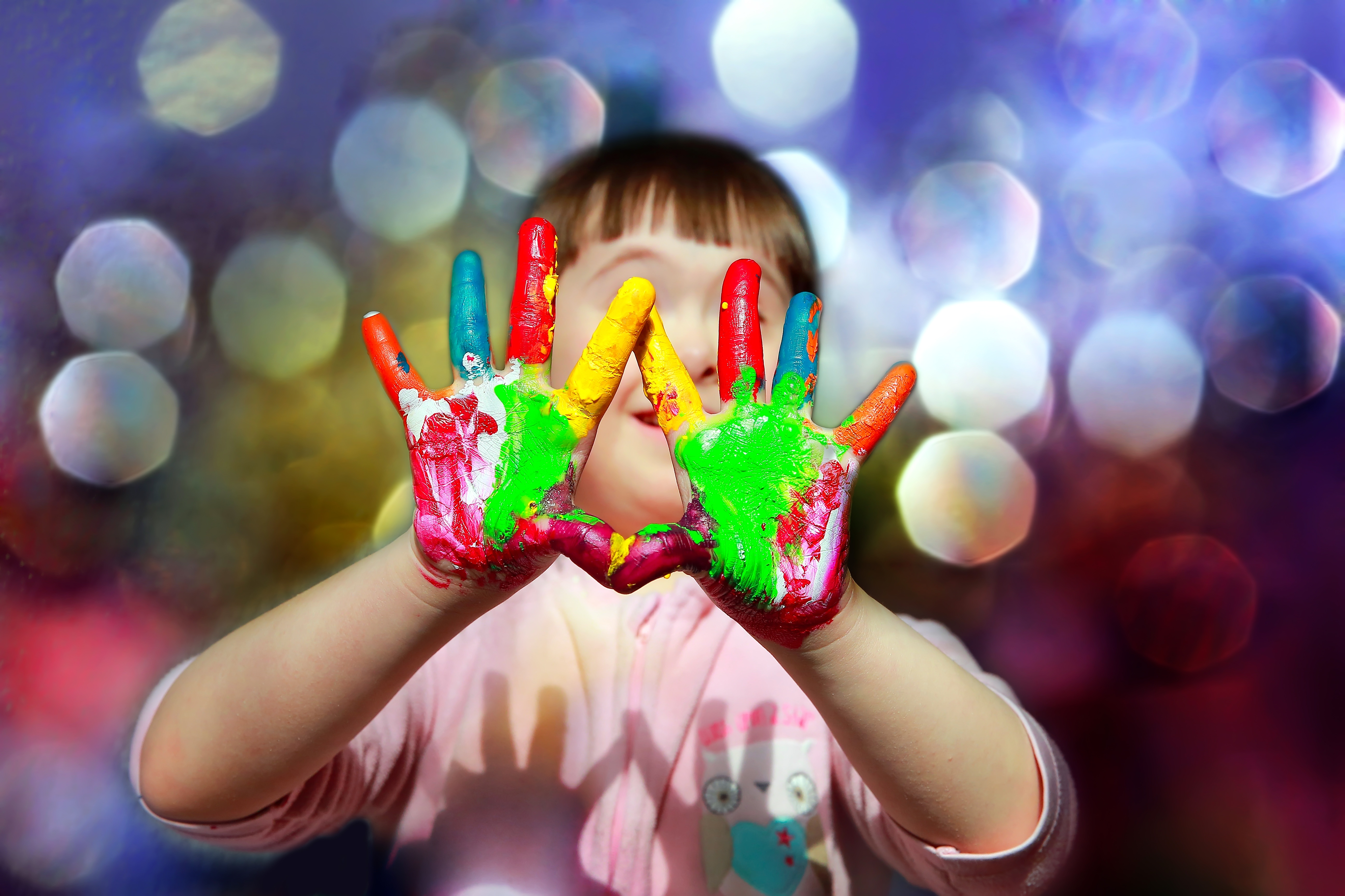 Cute-little-kid-with-painted-hands-539006670_5184x3456